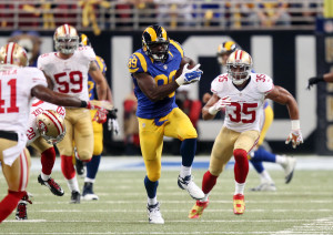 St. Louis Rams Jared Cook runs past the San Francisco 49er's defense for a 39 yard gain in the first quarter at the Edward Jones Dome in St. Louis on October 13, 2014.   UPI/Bill Greenblatt