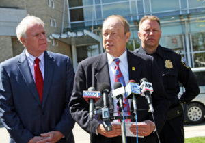 Attorney Michael Hupy announces the reward during a press conference in Milwaukee.