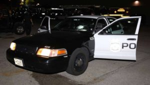 Milwaukee Police say an officer was injured when a rock broke the windshield of this squad car (Photo: MPD)