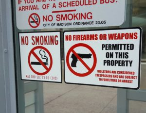 Signs on a Madison bus terminal. (Photo: Andrew Beckett)