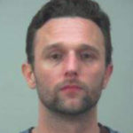Madison fugitive found hiding in wall